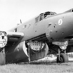 Wrecked Royal Air Force Avro Shackleton AEW2 (WL741) formerly of 8 Squadron, on fire dump, RAF Manston airfield, United Kingdom 1982