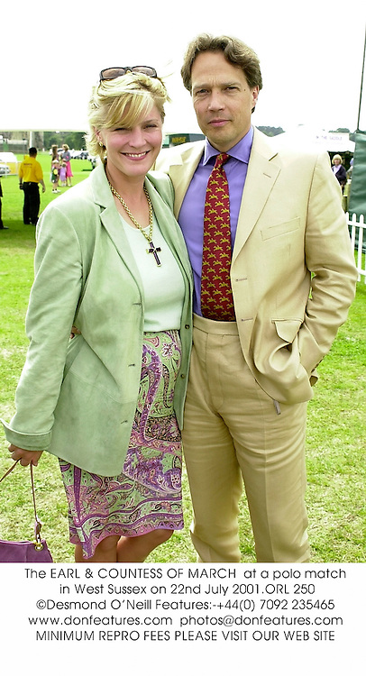 The EARL & COUNTESS OF MARCH  at a polo match in West Sussex on 22nd July 2001.	ORL 250