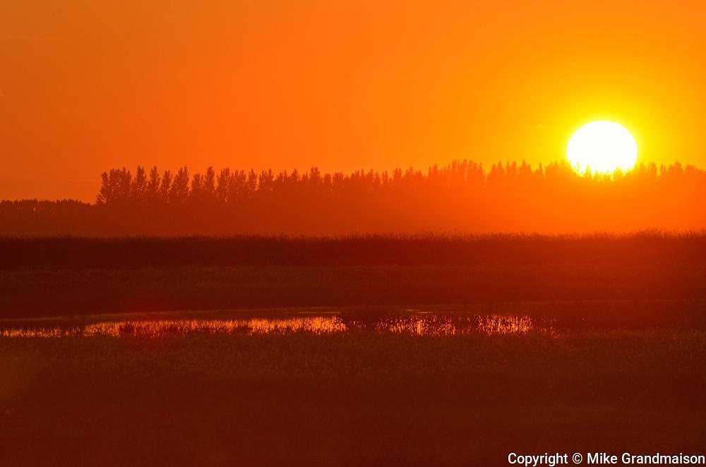 Sun setting on farm<br /> Craven<br /> Saskatchewan<br /> Canada