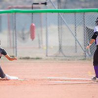 Gallup Bengal Ciara Spencer (4), left, awaits the throw as Miyamura Patriot Jazmine Arreguin (5) sprints to first base at Gallup High School Friday.