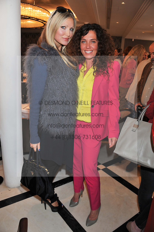 Left to right, CAPRICE BOURRET and TARA SMITH at a lunch to launch Cash & Rocket on Tour 2013 hosted by Julia Brangstrup in aid of Orpan Aid and Shine on Sierrra Leone held at Banca, 40 North Audley Street, London on 29th April 2013.