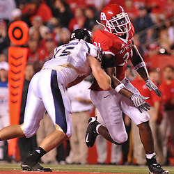 Sep 19, 2009; Piscataway, NJ, USA; Florida International tight end Colt Anderson (15) blocks Rutgers defensive end George Johnson (31) during the second half of Rutgers' 23-15 victory over Florida International at Rutgers Stadium.