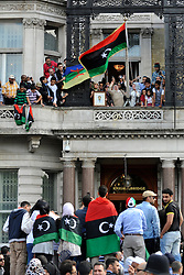 © licensed to London News Pictures. LONDON, UK.  09/08/11. The flag is changed at the Libyan Embassy in London. Diplomats named by Libya's rebel administration, the National Transitional Council (NTC), took over the London embassy today (Tues 9th August 2011) previously staffed by appointees of Muammar Gaddafi's government Mandatory Credit Stephen Simpson/LNP
