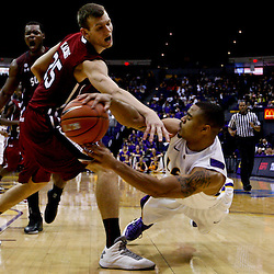 Jan 16, 2013; Baton Rouge, LA, USA; LSU Tigers guard Malik Morgan (24) passes as falls to the ground being defended by South Carolina Gamecocks forward Mindaugas Kacinas (25)during the second half of a game at the Pete Maravich Assembly Center. South Carolina defeated LSU 82-73. Mandatory Credit: Derick E. Hingle-USA TODAY Sports
