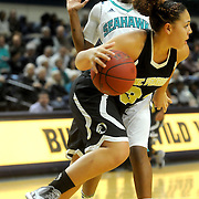 UNCW's Johanna McMillan guards UNCP's Katelyn Mitchell Sunday November 16, 2014 at Trask Coliseum in Wilmington, N.C. (Jason A. Frizzelle)