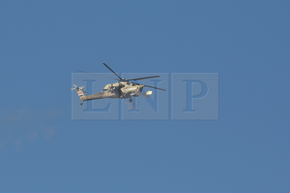 Licensed to London News Pictures. 20/02/2017. Albu Saif, Iraq. An Iraqi Army Aviation Mi-28 attack helicopter fires its 30mm canon into the village of Albu Saif as Iraqi security forces continue with the offensive to retake western Mosul from Islamic State forces.<br /> <br /> The settlement of Albu Saif is located on high ground overlooking Mosul Airport and as such is a strategic point that needs to be taken as part of the operation to retake the western side of Mosul. Photo credit: Matt Cetti-Roberts/LNP