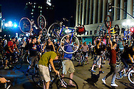 Critical Mass cyclists obstruct an intersection in downtown San Diego, California on June 27, 2008.