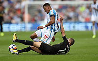 Football - 2017 / 2018 Premier League - Huddersfield Town vs. Newcastle United<br /> <br /> Rajiv van La Parra of Huddersfield Town and Javi Manquillo of Newcastle United at The John Smith Stadium.<br /> <br /> COLORSPORT/LYNNE CAMERON