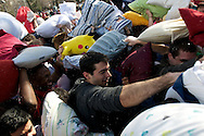 April 2, 2011 - People participate in a giant pillow fight on Saturday on Cambridge Common. Approximatley 1000 people came out to participate in the International Pillow Fight Day event, which was organized by the Mysterious Banditous. Photo by Lathan Goumas.