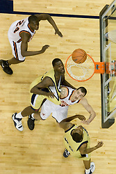 Virginia Cavaliers forward Jason Cain (33) tugs on a GT jersey under the basket.  The Virginia Cavaliers Men's Basketball Team defeated the Georgia Tech Yellow Jackets 75-69 at the John Paul Jones Arena in Charlottesville, VA on February 24, 2007.