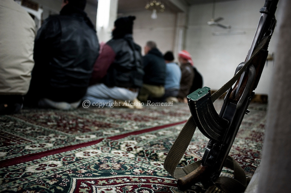 SYRIA - Al Qsair. Members of Free Syrian Army pray in a mosque in Al Qsair, on January 24, 2012. Al Qsair is a small town of 40000 inhabitants, located 25Km south-west of Homs. The town is besieged since the beginning of November and so far it counts 65 dead. ALESSIO ROMENZI