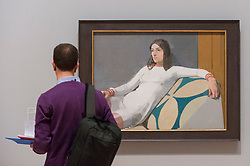 "© Licensed to London News Pictures. 26/02/2018. LONDON, UK. A visitor views ""Georgia"", 1973, by Euan Uglow.  Preview of ""All Too Human"", an exhibition at Tate Britain which explores how artists in Britain have stretched the possibilities of paint in order to capture life around them.  The exhibition runs 28 February to 27 August 2018 and includes rarely seen works by Lucian Freud and Francis Bacon.  Photo credit: Stephen Chung/LNP"