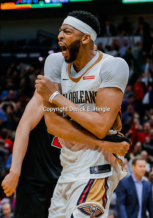 Jan 22, 2018; New Orleans, LA, USA; New Orleans Pelicans forward Anthony Davis (23) reacts after a dunk against the Chicago Bulls during the fourth quarter at the Smoothie King Center. The Pelicans defeated the Bulls 132-128 in double overtime. Mandatory Credit: Derick E. Hingle-USA TODAY Sports