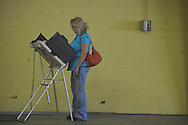 Lorene McGee votes in a primary runoff election at the old National Guard Armory in Oxford, Miss. on Tuesday, August 23, 2011.