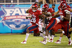 September 16, 2017 - Boca Raton, Florida, U.S. - Florida Atlantic Owls cornerback Chris Tooley (26) returns a fumble for a touchdown to give the Owls a 45-0 lead over Bethune Cookman Wildcats in Boca Raton, Florida on September 16, 2017. (Credit Image: © Allen Eyestone/The Palm Beach Post via ZUMA Wire)