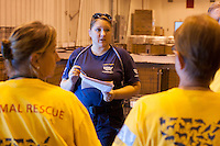 Melissa Szumlinksi, shelter manager of the temporary shelter set up at the Columbia, SC airport, speaks with her team after a raid on a puppy mill in Johnston, SC on Tuesday, Sept. 11, 2012. HSUS workers found over 200 dogs, nine horses and 30-40 fowl.
