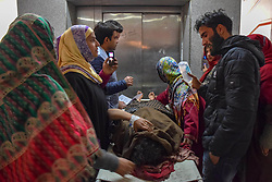 November 20, 2018 - Srinagar, Jammu & Kashmir, India - An injured Kashmiri woman is seen wheeled on a stretcher in Srinagar's Hospital after she was fired upon during a protest against killing of 4 militants in a gunfight in south Kashmir's Shopian district. .Two  girls were among four civilians injured during clashes near the site of a gunfight in Nadigam village of south Kashmir's Shopian district on Tuesday. Four militants and an Indian armyman were killed during the gunfight in south Kashmir. (Credit Image: © Idrees Abbas/SOPA Images via ZUMA Wire)