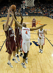 Virginia's Siedah Williams (4) tries to grab a rebound from BC's Kathrin Ress (11).  The Cavaliers defeated the Eagles 65-63 in overtime at the John Paul Jones Arena in Charlottesville, VA on January 14, 2007.