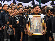 29 OCTOBER 2016 - BANGKOK, THAILAND:   People wait in line on the grounds of the Grand Palace in Bangkok to pay homage to the late Bhumibol Adulyadej, the King of Thailand. Saturday was the first day Thais could pay homage to the funeral urn of the late Bhumibol Adulyadej, King of Thailand, at Dusit Maha Prasart Throne Hall in the Grand Palace. The Palace said 10,000 people per day would be issued free tickerts to enter the Throne Hall but by late Saturday morning more than 100,000 people were in line and the palace scrapped plans to require mourners to get the free tickets. Traditionally, Thai Kings lay in state in their urns, but King Bhumibol Adulyadej is breaking with tradition. His urn reportedly contains some of his hair, but the King is in a coffin,  not in the urn. The laying in state will continue until at least January 2017 but may be extended.     PHOTO BY JACK KURTZ