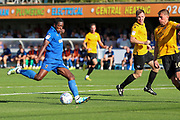 AFC Wimbledon attacker Michael Folivi (17) with a shot on goal during the EFL Sky Bet League 1 match between AFC Wimbledon and Bristol Rovers at the Cherry Red Records Stadium, Kingston, England on 21 September 2019.