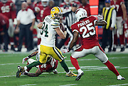 Arizona Cardinals free safety Rashad Johnson (26) and Arizona Cardinals cornerback Jerraud Powers (25) chase Green Bay Packers wide receiver Jeff Janis (83) on a second quarter pass reception good for a first down during the NFL NFC Divisional round playoff football game against the Arizona Cardinals on Saturday, Jan. 16, 2016 in Glendale, Ariz. The Cardinals won the game in overtime 26-20. (©Paul Anthony Spinelli)