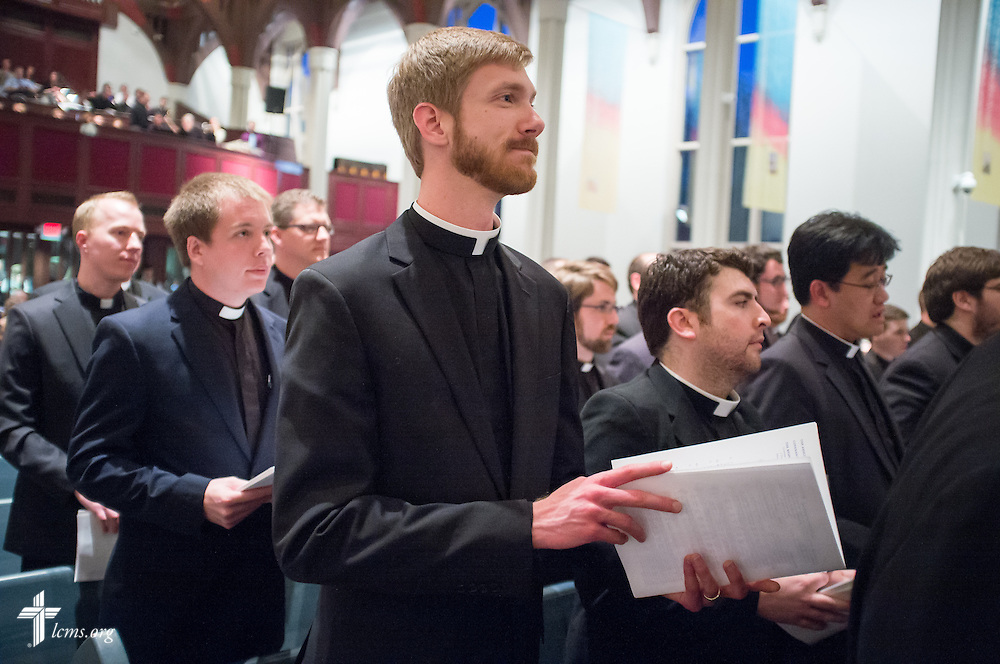Jonathan Meyer, a candidate for ministry called as Assistant Pastor to Holy Trinity Lutheran Church in Edmond, Okla., attends an evening worship Tuesday, April 29, 2014, during 'call day' in the Chapel of St. Timothy and St. Titus at Concordia Seminary, St. Louis. The Rev. Dr. Russell L. Sommerfeld, president of the LCMS Nebraska District, served as preacher. LCMS Communications/Erik M. Lunsford