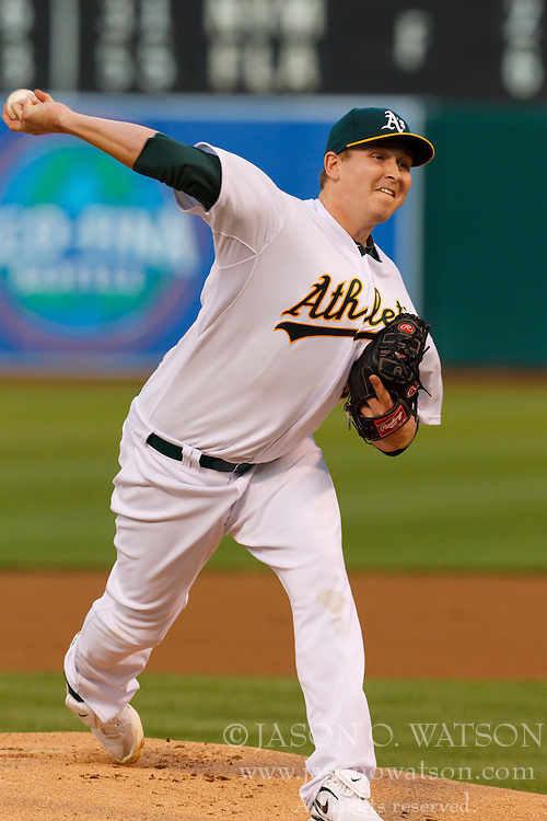 April 1, 2011; Oakland, CA, USA;  Oakland Athletics starting pitcher Trevor Cahill (53) pitches against the Seattle Mariners during the first inning at Oakland-Alameda County Coliseum.