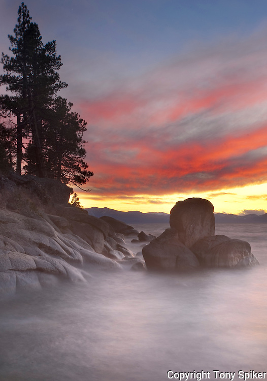 """""""East Shore Sunset 2"""" - The sun sets over Lake Tahoe while waves roll in near Secret Harbor"""