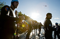 JEROME A. POLLOS/Press..Ironman participants wait to enter the water of Lake Coeur d'Alene to begin the 2.4-mile swim Sunday during the Ford Ironman Coeur d'Alene.