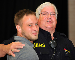 Former Bethlehem Township paramedic AJ Heightman reunites with the Barron Family including Rodney Barron, II (left) who Heightman cared for as a premature baby 27 years ago on April  23, 2017, in Bethlehem Township. Heightman has not seen Barron since he assisted in his care when Barron was born prematurely at home 27 years ago. (Chris Post   lehighvalleylive.com contributor)