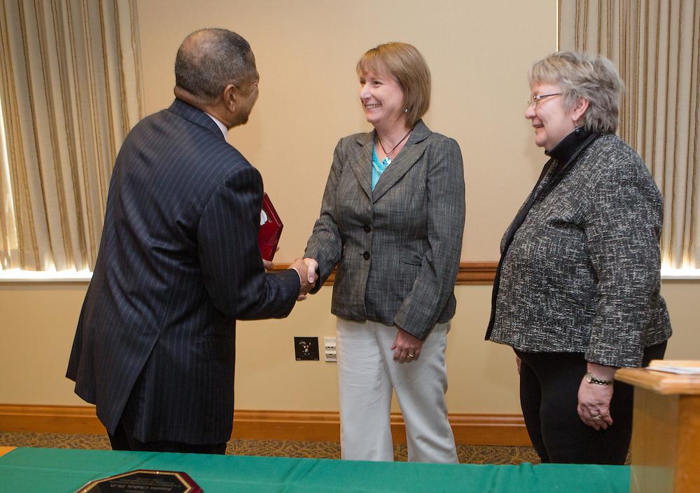 Ohio University President Roderick McDavis and Executive Vice President and Provost Pam Benoit congratulate Julia Paxton during the Presidential Teacher Awards in the Multicultural Center on Sept. 23, 2014. Photo by Lauren Pond