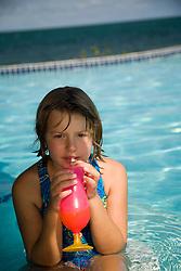 Girl with drink in pool at Jaguar Reef Lodge, Hopkins, Stann Creek District, Belize, Central America   PR, MR