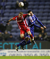 Photo: Steve Bond/Richard Lane Photography. Leicester City v Leyton Orient. Coca Cola League One. 10/01/2009. Jack Hobbs (R) and Ryan Jarvis (L) challange in the air