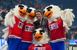 Photographer Vid Ponikvar with mascots Tasa after the final handball match between Serbia and Denmark at 10th EHF European Handball Championship Serbia 2012, on January 29, 2012 in Beogradska Arena, Belgrade, Serbia. Denmark defeated Serbia 21-19 and became European Champion 2012. (Photo By Vid Ponikvar / Sportida.com)