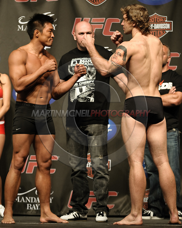 LAS VEGAS, NEVADA, JULY 10, 2009: Yoshihiro Akiyama (left) and Alan Belcher face off during the weigh-in for UFC 100 inside the Mandalay Bay Events Center in Las Vegas, Nevada