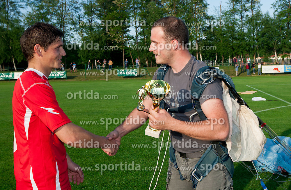Denis Topolovec of Aluminij accepting trophy from parachuter after the football match between NK Aluminij Kidricevo and NK Roltek Dob in 27th, last Round of 2nd SNL, on May 19, 2012 in Sports park Kidricevo, Slovenia. NK Aluminij defeated NK Dob 2-1, won 2nd SNL and qualified to 1st SNL. (Photo by Vid Ponikvar / Sportida.com)