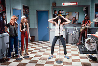 """ca. 1977-1979, Manhattan, New York City, New York State, USA --- Gilda Radner does a comic impersonation of punk rock singer Patti Smith in a sketch from """"Saturday Night Live"""". Fellow cast members Jane Curtin and Laraine Newman act as her backup singers. --- Image by © Owen Franken/Corbis"""