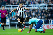 Dwight Gayle (#9) of Newcastle United takes advantage as Nathan Ake (#5) of AFC Bournemouth slips during the Premier League match between Newcastle United and Bournemouth at St. James's Park, Newcastle, England on 4 November 2017. Photo by Craig Doyle.