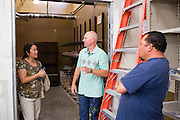 Ceramics teacher Jeff Albrech talks with parents Kevin Balsbaugh, right, and Barbara Knitter, left, during Milpitas High School's Back to School Night at Milpitas High School in Milpitas, California, on September 1, 2015. (Stan Olszewski/SOSKIphoto)