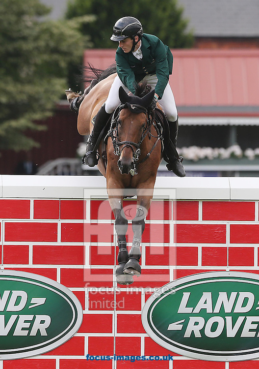 Ireland's Eoin Mcmahon on King Lux pictured during the Puissance competition  during the Dublin Horse Show at Royal Dublin Society, Ballsbridge<br /> Picture by Lorraine O'Sullivan/Focus Images Ltd +353 872341234<br /> 23/07/2016