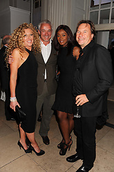 Left to right, KELLY HOPPEN,  JOHN GARDNER, PHOEBE VELA and JOHN HITCHCOX at a reception to present the new Cartier Tank Watch Collection held at The Orangery, Kensington Palace Gardens, London W8 on 19th April 2012.