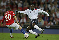 Photo: Rich Eaton.<br /> <br /> England v Russia. UEFA European Championships Qualifying. 12/09/2007. Russia's Igor Semshov (L) is challenged by England's Emile Heskey