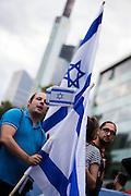Frankfurt am Main | 04 Aug 2014<br /> <br /> Am Montag (04.08.2014) demonstrierten in Frankfurt am Main etwa 400 Menschen aus verschiedenen linken und linksradikalen Gruppen, aus der j&uuml;dischen Gemeinde und der Frankfurter Stadtgesellschaft gegen Antisemitismus und Judenhass. In den vergangenen Wochen war es in der Bankenstadt immer wieder zu antisemitischen Vorf&auml;llen wie Schmierereien an einer Synagoge, Hass-Kundgebungen oder einer eingeworfenen Scheibe bei einer j&uuml;dischen Familie und Beschimpfungen als &quot;Judenschweine&quot; gekommen.<br /> Hier: Die Flagge von Israel vor der Commerzbank.<br /> <br /> &copy;peter-juelich.com<br /> <br /> [No Model Release | No Property Release]