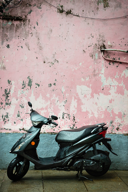 Scooter and pink wall in Macau
