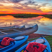 South Florida kayaking outdoors adventure photography from landscape photographer Juergen Roth showing kayaks with a stunning sunset across Loxahatchee National Wildlife Refuge located west of Boynton Beach in Palm Beach County, FL. Arthur R. Marshall Loxahatchee National Wildlife Refuge is an amazing area for viewing wildlife and photography in Florida. <br />