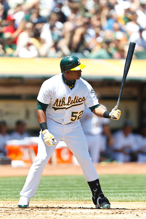 OAKLAND, CA - JULY 22: Yoenis Cespedes #52 of the Oakland Athletics at bat against the New York Yankees during the first inning at O.co Coliseum on July 22, 2012 in Oakland, California.  The Oakland Athletics defeated the New York Yankees 5-4 in 12 innings. (Photo by Jason O. Watson/Getty Images) *** Local Caption *** Yoenis Cespedes