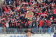 15 December 2013: Maryland fans celebrate after a goal. The University of Maryland Terripans played the University of Notre Dame Fighting Irish at PPL Park in Chester, Pennsylvania in a 2013 NCAA Division I Men's College Cup championship match. Notre Dame won the game 2-1.