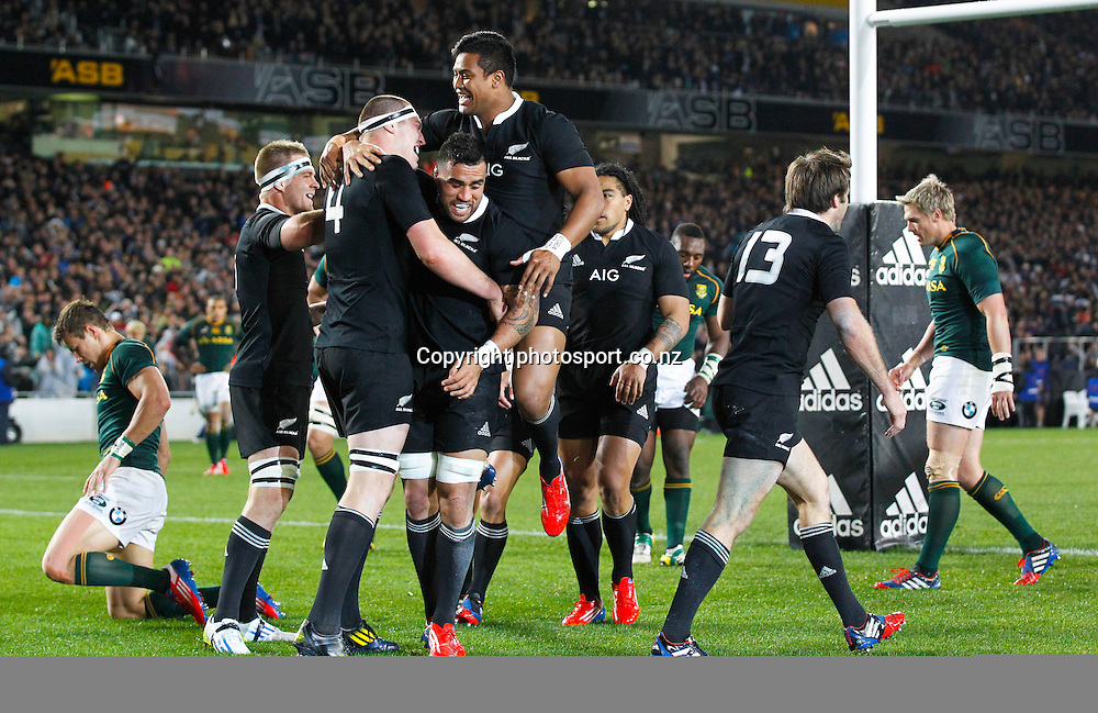 New Zealand's Brodie Retallick, left, is congratulated by team mates after scoring a try. The Rugby Championship. New Zealand All Blacks versus South Africa. Rugby Union. Eden Park, Auckland, New Zealand. Saturday 14 September 2013. Photo: Photosport.co.nz