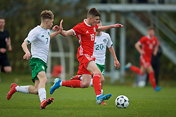 WREXHAM, WALES - Wednesday, October 30, 2019: Wales' Joel Cotterill (R) gets away from Republic of Ireland's Cian Kelly during the 2019 Victory Shield match between Wales and Republic of Ireland at Colliers Park. (Pic by David Rawcliffe/Propaganda)