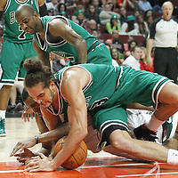 17 March 2012: Chicago Bulls center Joakim Noah (13) vies for the loose ball with Philadelphia Sixers forward Thaddeus Young (21) during the Chicago Bulls 89-80 victory over the Philadelphia Sixers at the United Center, Chicago, Illinois, USA.